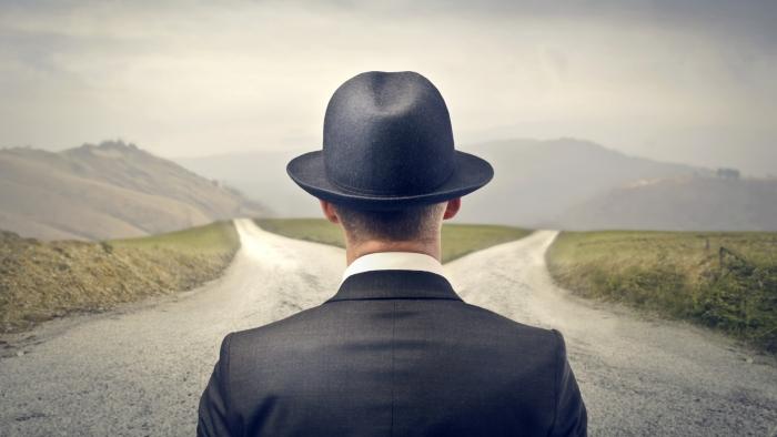 Man-Choosing-Between-Two-Roads